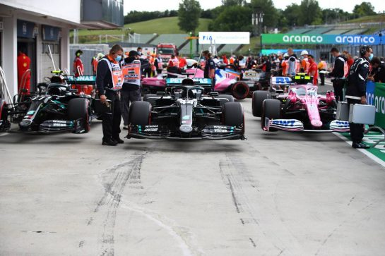 The top three cars in qualifying parc ferme (L to R): Valtteri Bottas (FIN) Mercedes AMG F1 W11; Lewis Hamilton (GBR) Mercedes AMG F1 W11; Lance Stroll (CDN) Racing Point F1 Team RP20.
