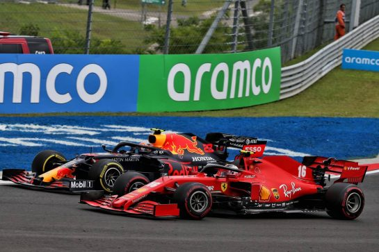 Charles Leclerc (MON) Ferrari SF1000 and Alexander Albon (THA) Red Bull Racing RB16 battle for position.