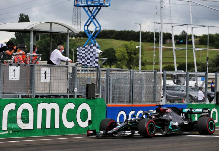 Race winner Lewis Hamilton (GBR) Mercedes AMG F1 takes the chequered flag at the end of the race.