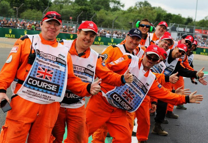 Marshals on the drivers parade. 14.07.2019.