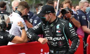 Bottas sets sights on victory after clinching pole