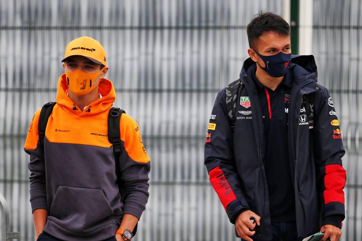 Lando Norris (GBR) McLaren with Alexander Albon (THA) Red Bull Racing. 09.08.2020. Formula 1 World Championship, Rd 5, 70th Anniversary Grand Prix, Silverstone, England, Race Day.