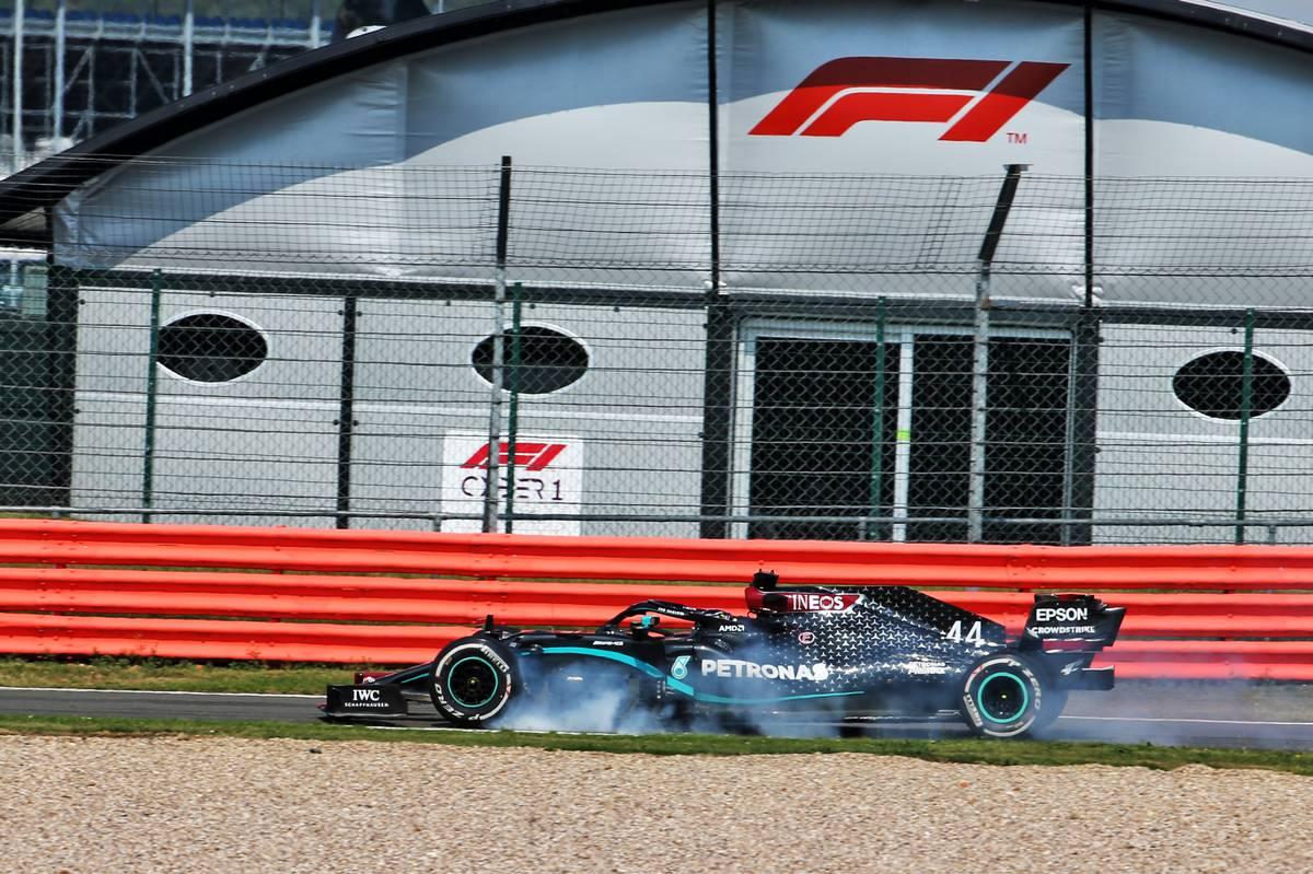 Lewis Hamilton (GBR) Mercedes AMG F1 W11 locks up under braking entering the pits.