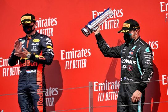 (L to R): Race winner Max Verstappen (NLD) Red Bull Racing with third placed Valtteri Bottas (FIN) Mercedes AMG F1 on the podium. 09.08.2020. Formula 1 World Championship, Rd 5, 70th Anniversary Grand Prix, Silverstone, England, Race Day. - www.xpbimages.com, EMail: requests@xpbimages.com © Copyright: Dungan / XPB Images