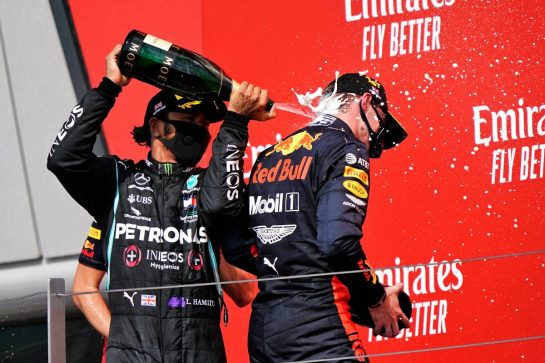 (L to R): Lewis Hamilton (GBR) Mercedes AMG F1 celebrates his second position on the podium with race winner Max Verstappen (NLD) Red Bull Racing. 09.08.2020. Formula 1 World Championship, Rd 5, 70th Anniversary Grand Prix, Silverstone, England, Race Day. - www.xpbimages.com, EMail: requests@xpbimages.com © Copyright: Dungan / XPB Images