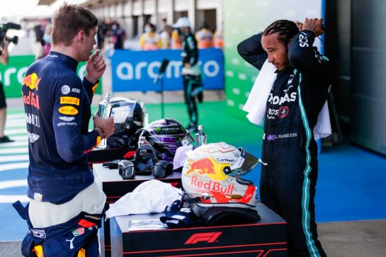 (L to R): Max Verstappen (NLD) Red Bull Racing and Lewis Hamilton (GBR) Mercedes AMG F1 in qualifying parc ferme.