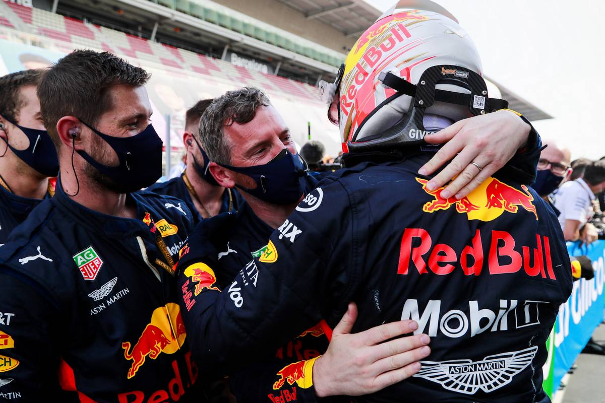 Max Verstappen (NLD) Red Bull Racing celebrates his second position in parc ferme with the team.