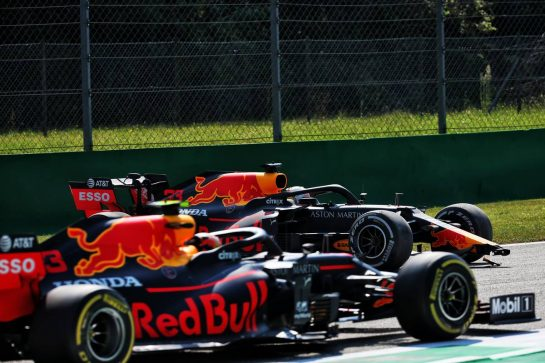 Alexander Albon (THA) Red Bull Racing RB16 passes his team mate Max Verstappen (NLD) Red Bull Racing RB16, who spun in the first practice session.