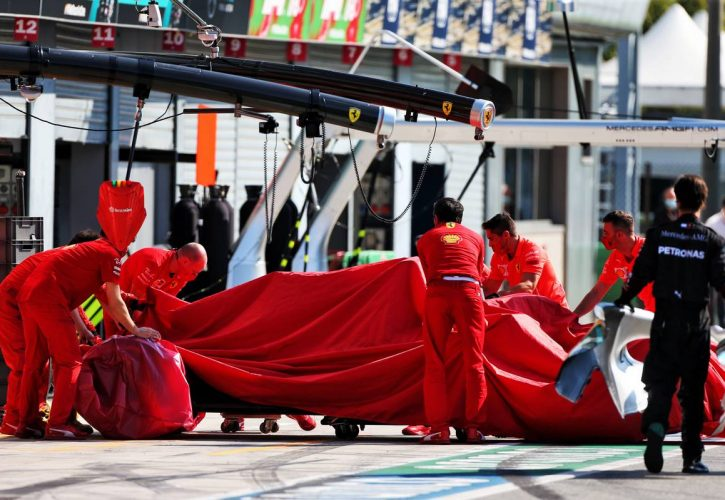 The Ferrari SF1000 of race retiree Charles Leclerc (MON) Ferrari is recovered back to the pits and an engine cover for Valtteri Bottas (FIN) Mercedes AMG F1 is brought out.
