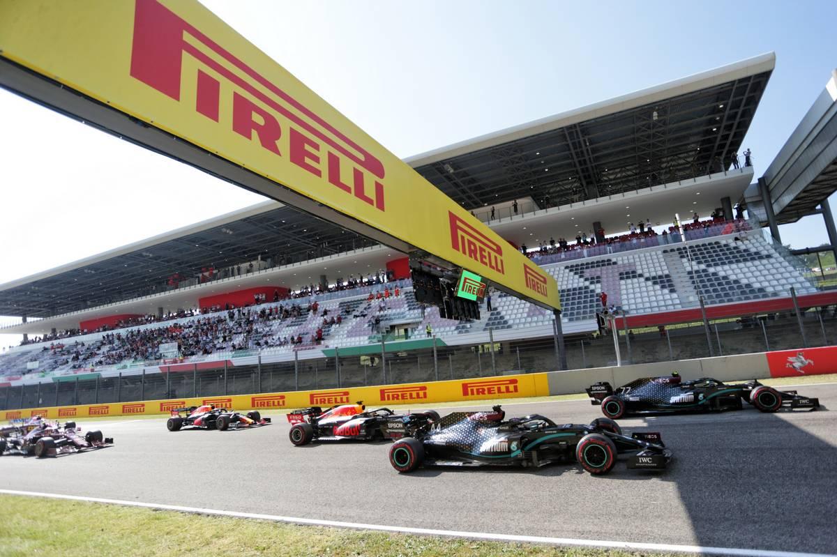 Valtteri Bottas (FIN) Mercedes AMG F1 W11 leads Lewis Hamilton (GBR)