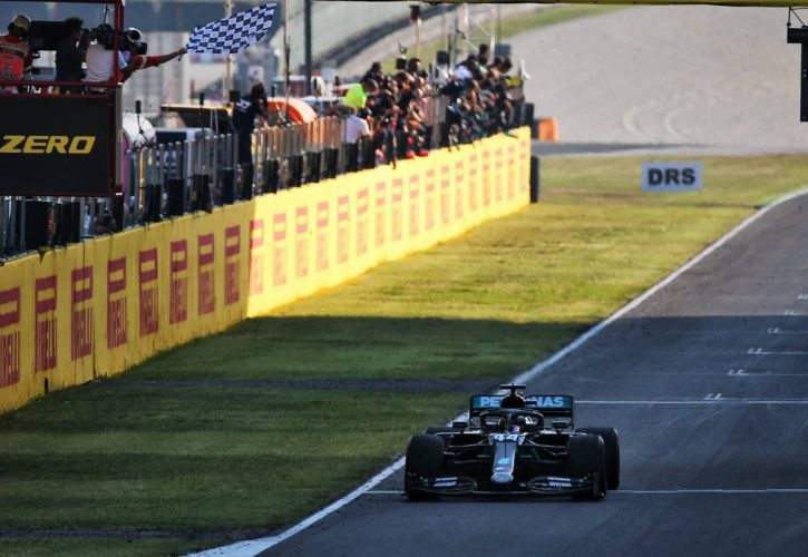 Race winner Lewis Hamilton (GBR) Mercedes AMG F1 W11 takes the chequered flag at the end of the race.
