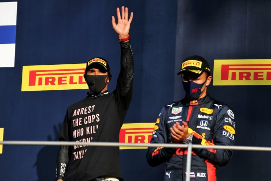 (L to R): race winner Lewis Hamilton (GBR) Mercedes AMG F1 celebrates on the podium with third placed Alexander Albon (THA) Red Bull Racing. 13.09.2020. Formula 1 World Championship, Rd 9, Tuscan Grand Prix, Mugello, Italy, Race Day. - www.xpbimages.com, EMail: requests@xpbimages.com © Copyright: Batchelor / XPB Images