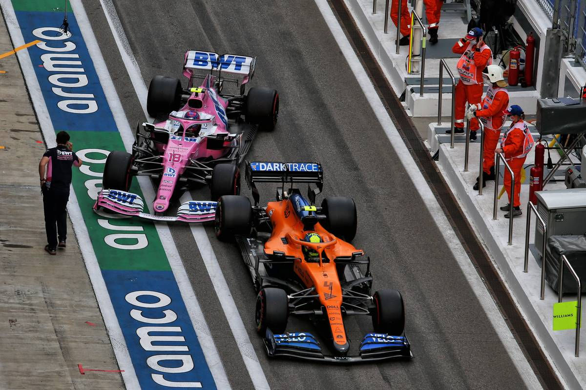 Lando Norris (GBR) McLaren MCL35 and Lance Stroll (CDN) Racing Point F1 Team RP20 in the pits.