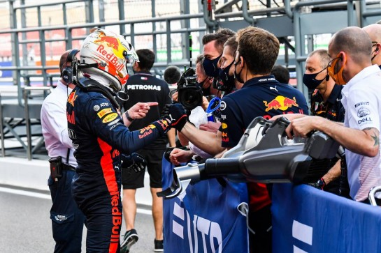 Max Verstappen (NLD) Red Bull Racing celebrates his second position with the team in qualifying parc ferme.