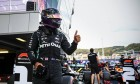 Lewis Hamilton (GBR) Mercedes AMG F1 W11 celebrates his pole position in qualifying parc ferme.