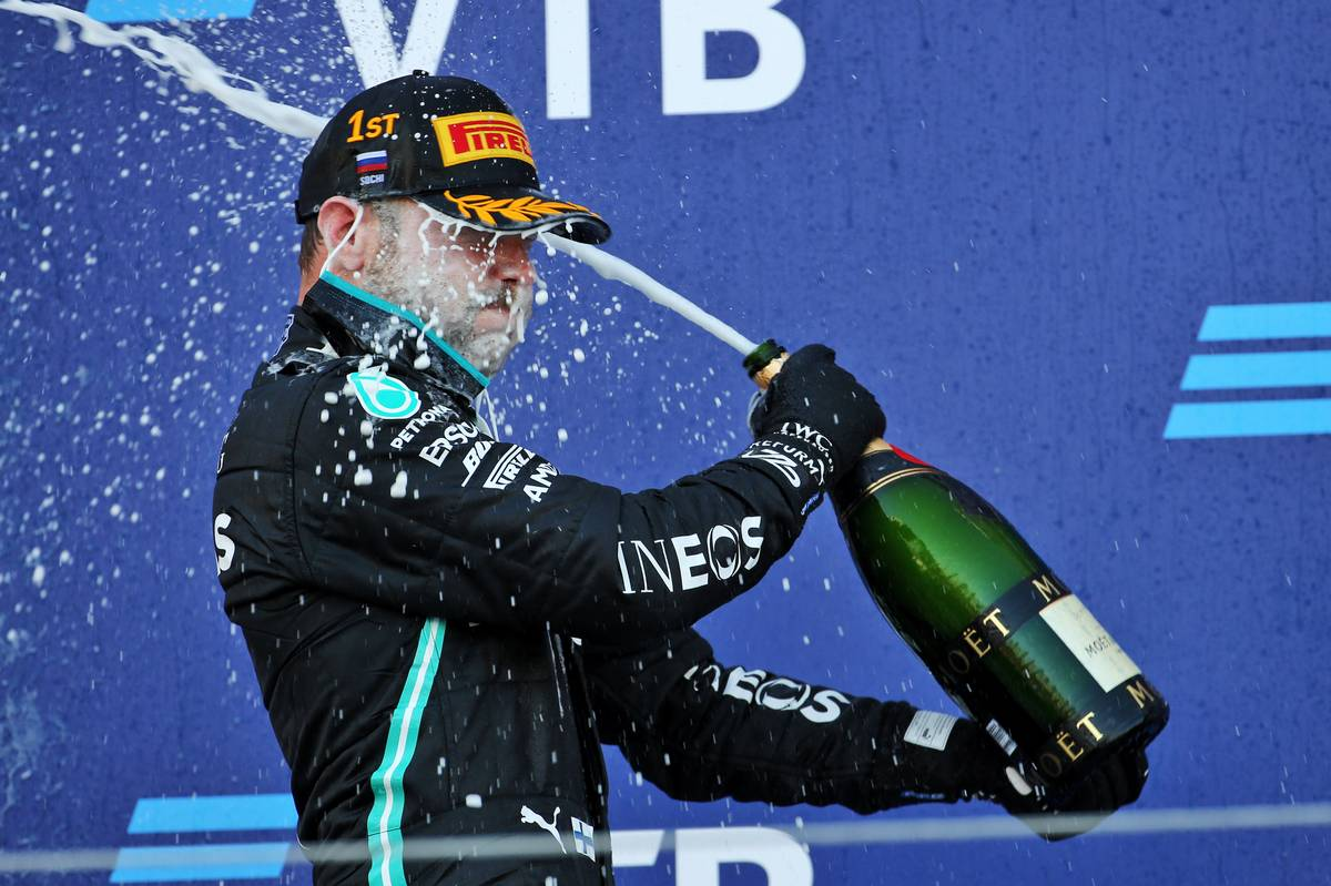 Race winner Valtteri Bottas (FIN) Mercedes AMG F1 celebrates with the champagne on the podium.
