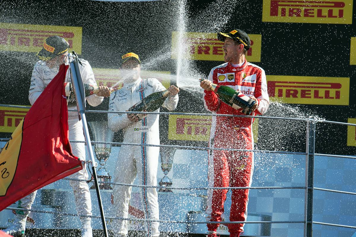 ace winner Lewis Hamilton (GBR) Mercedes AMG F1, third placed Felipe Massa (BRA) Williams and second placed Sebastian Vettel (GER) Ferrari celebrate on the podium.