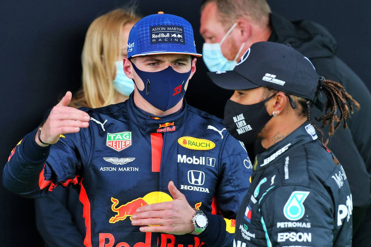 Max Verstappen (NLD) Red Bull Racing with Lewis Hamilton (GBR) Mercedes AMG F1 in parc ferme.