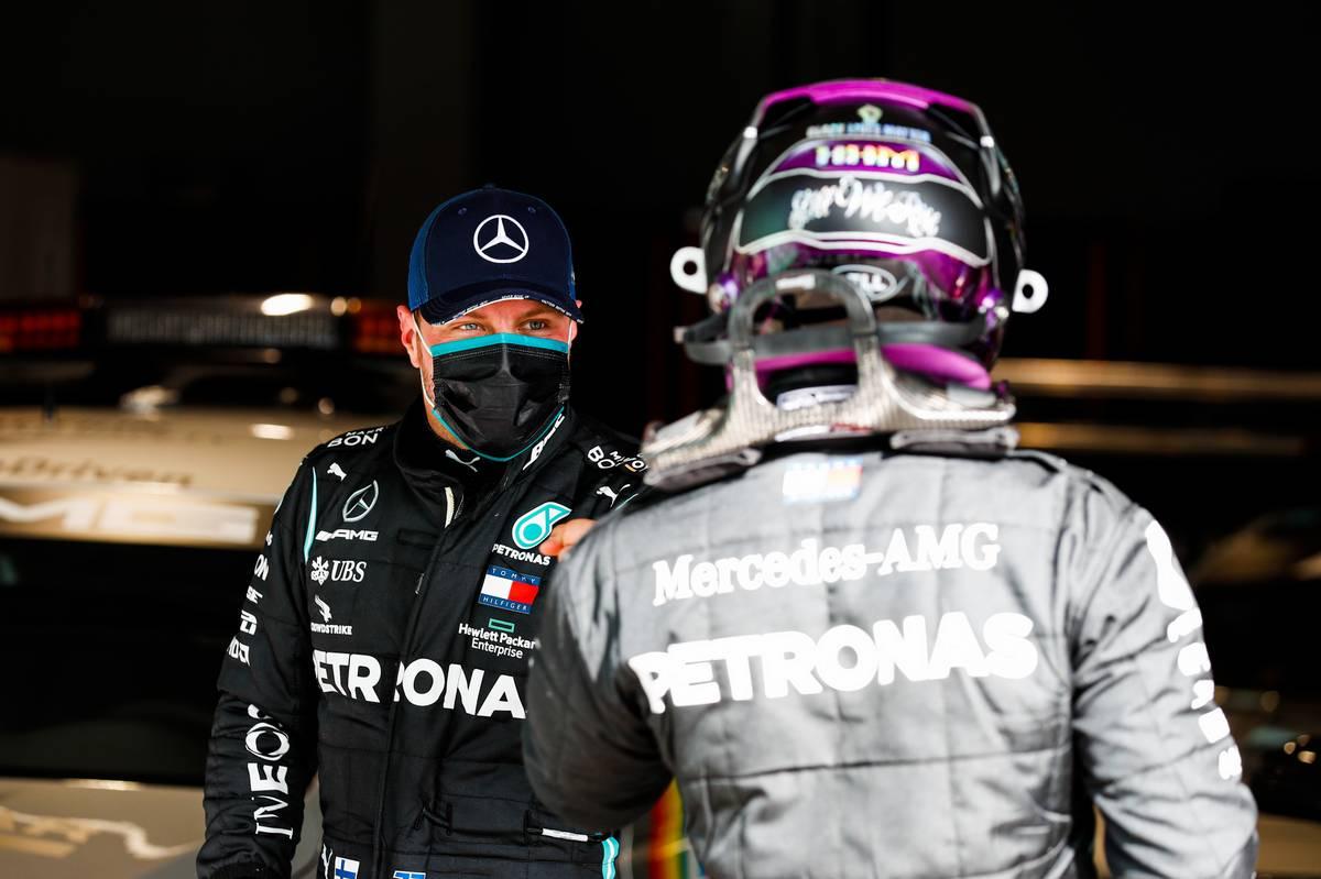 Valtteri Bottas (FIN) Mercedes AMG F1 with team mate Lewis Hamilton (GBR) Mercedes AMG F1 in qualifying parc ferme.
