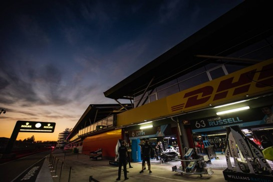 Williams Racing pits at sunset.