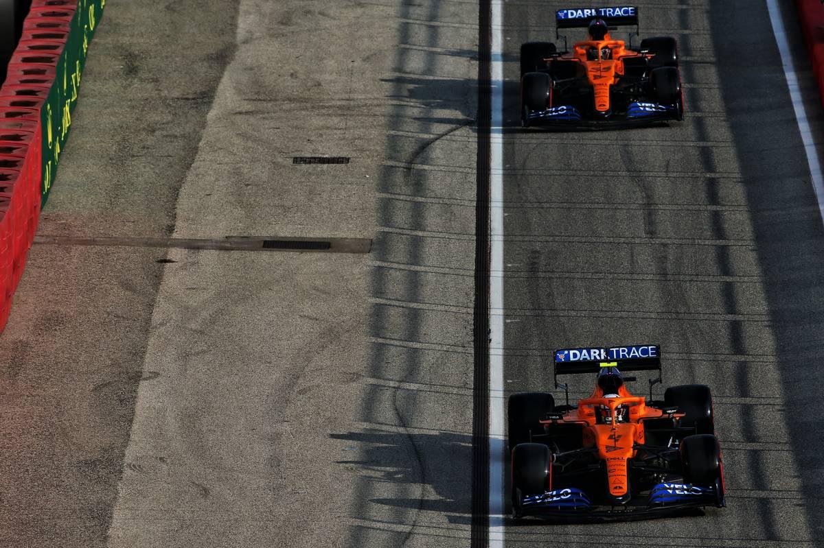 Lando Norris (GBR) McLaren MCL35 and Carlos Sainz Jr (ESP) McLaren MCL35.