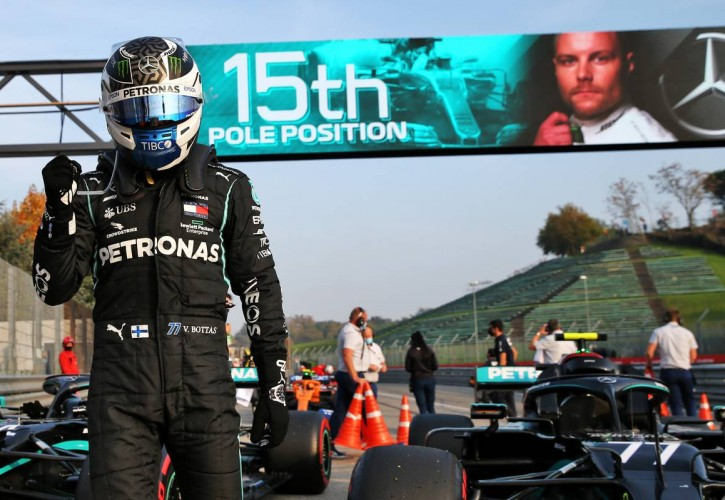Valtteri Bottas (FIN) Mercedes AMG F1 W11 celebrates his pole position in qualifying parc ferme.