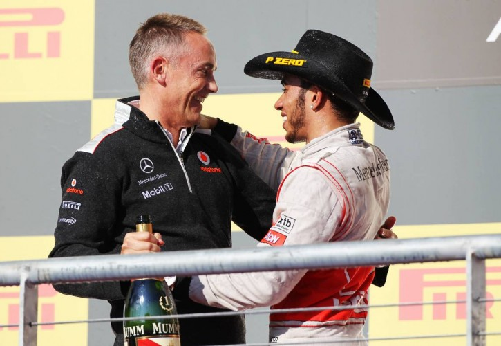 2012 US Grand Prix race winner Lewis Hamilton (GBR) McLaren celebrates on the podium with Martin Whitmarsh (GBR) McLaren Chief Executive Officer.