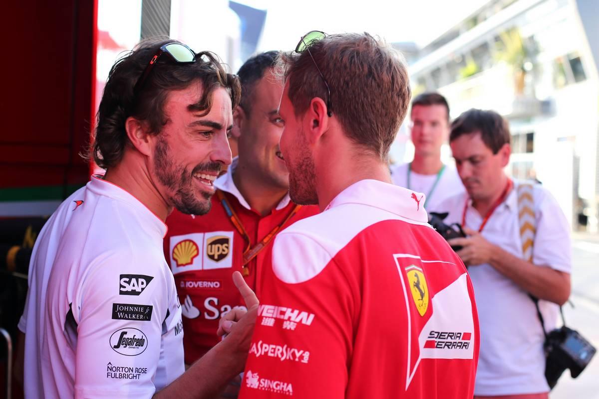 Fernando Alonso (ESP), McLaren Honda and Sebastian Vettel (GER), Scuderia Ferrari