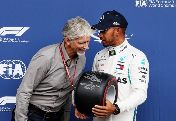 Lewis Hamilton (GBR) Mercedes AMG F1 receives the Pirelli Pole Position award from Damon Hill (GBR) Sky Sports Presenter.