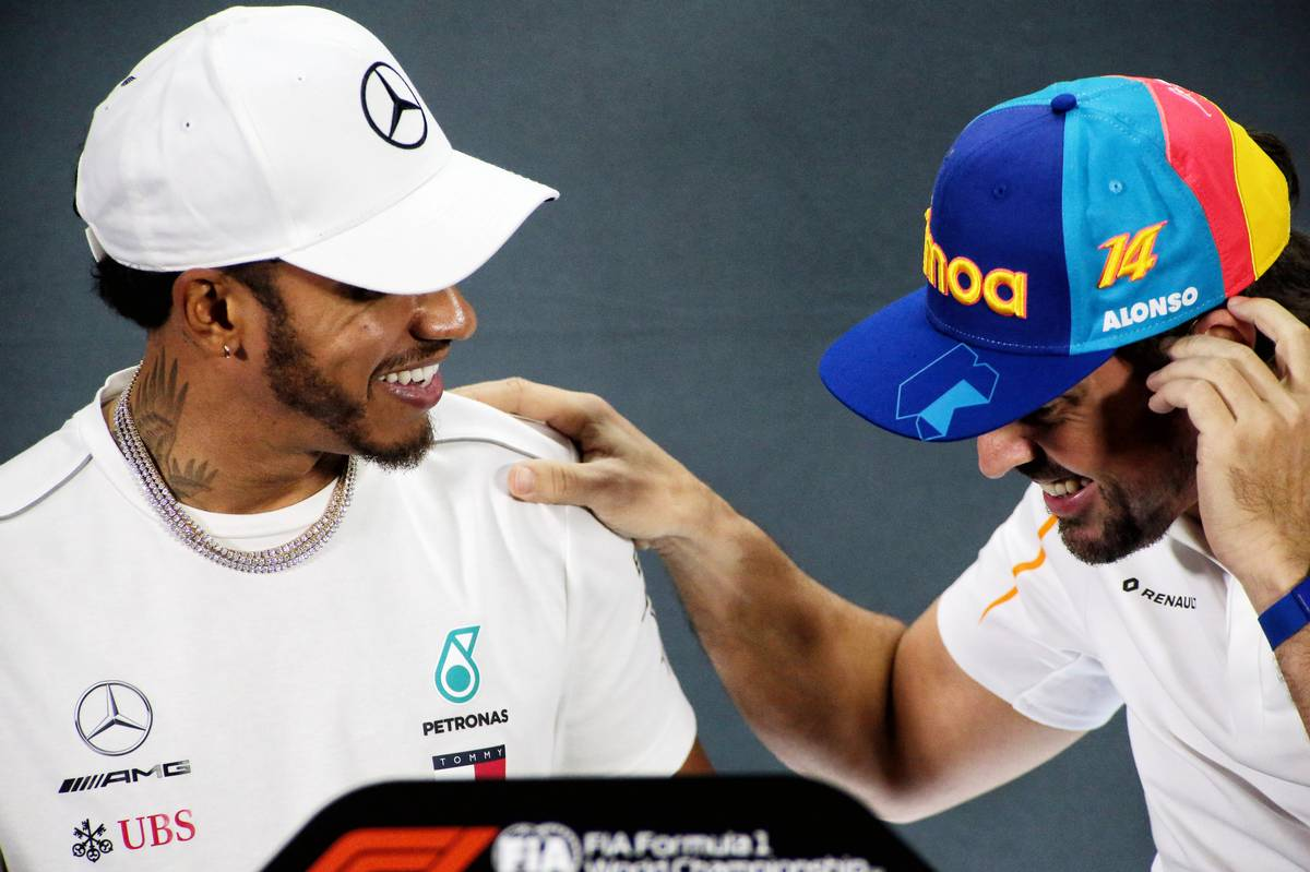 Lewis Hamilton (GBR) Mercedes AMG F1 with Fernando Alonso (ESP) McLaren in the FIA Press Conference.