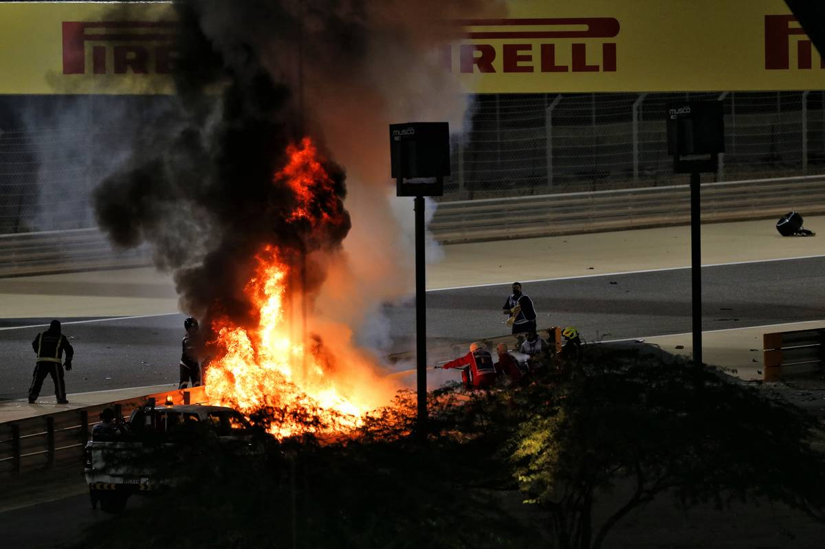 Marshals put out the fire of after Romain Grosjean (FRA) Haas F1 Team VF-20 crashed at the start of the race and exploded into flames. 29.11.2020. Formula 1 World Championship, Rd 15, Bahrain Grand Prix