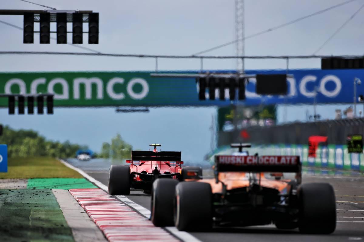 Charles Leclerc (MON) Ferrari SF1000 leads Carlos Sainz Jr (ESP) McLaren MCL35.