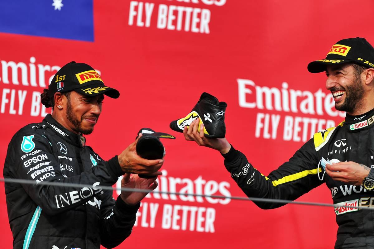 Race winner Lewis Hamilton (GBR) Mercedes AMG F1 celebrates on the podium with third placed Daniel Ricciardo (AUS) Renault F1 Team.