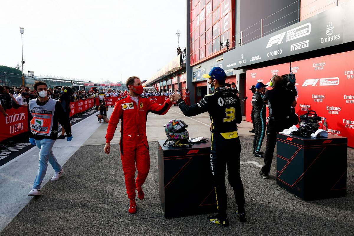 Sebastian Vettel (GER) Ferrari congratulates third placed Daniel Ricciardo (AUS) Renault F1 Team in parc ferme.