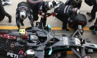 Valtteri Bottas (FIN) Mercedes AMG F1 W11 makes a pit stop. whilst a mechanic removes a Ferrari front wing end plate.