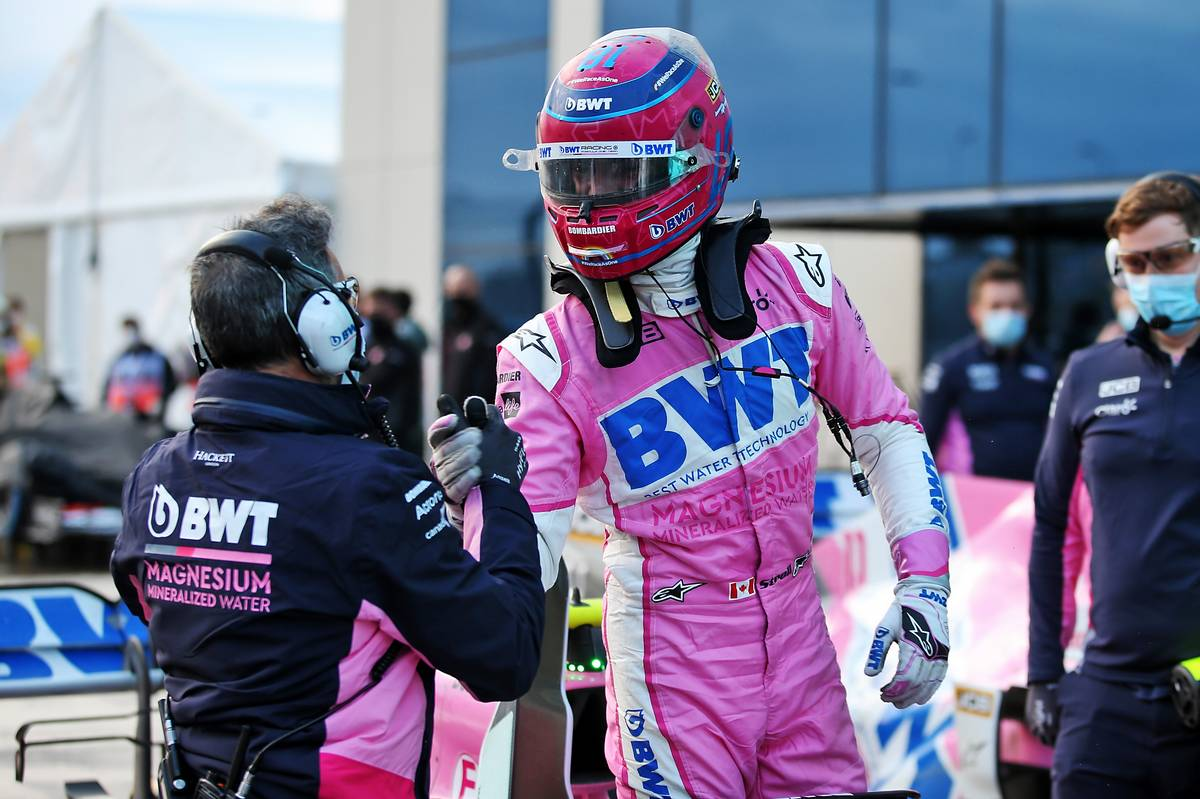 Lance Stroll (CDN) Racing Point F1 Team RP20 celebrates his pole position in qualifying parc ferme.