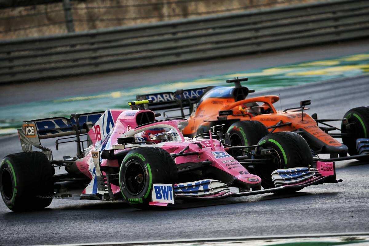 Lance Stroll (CDN) Racing Point F1 Team RP20 and Carlos Sainz Jr (ESP) McLaren MCL35 battle for position.