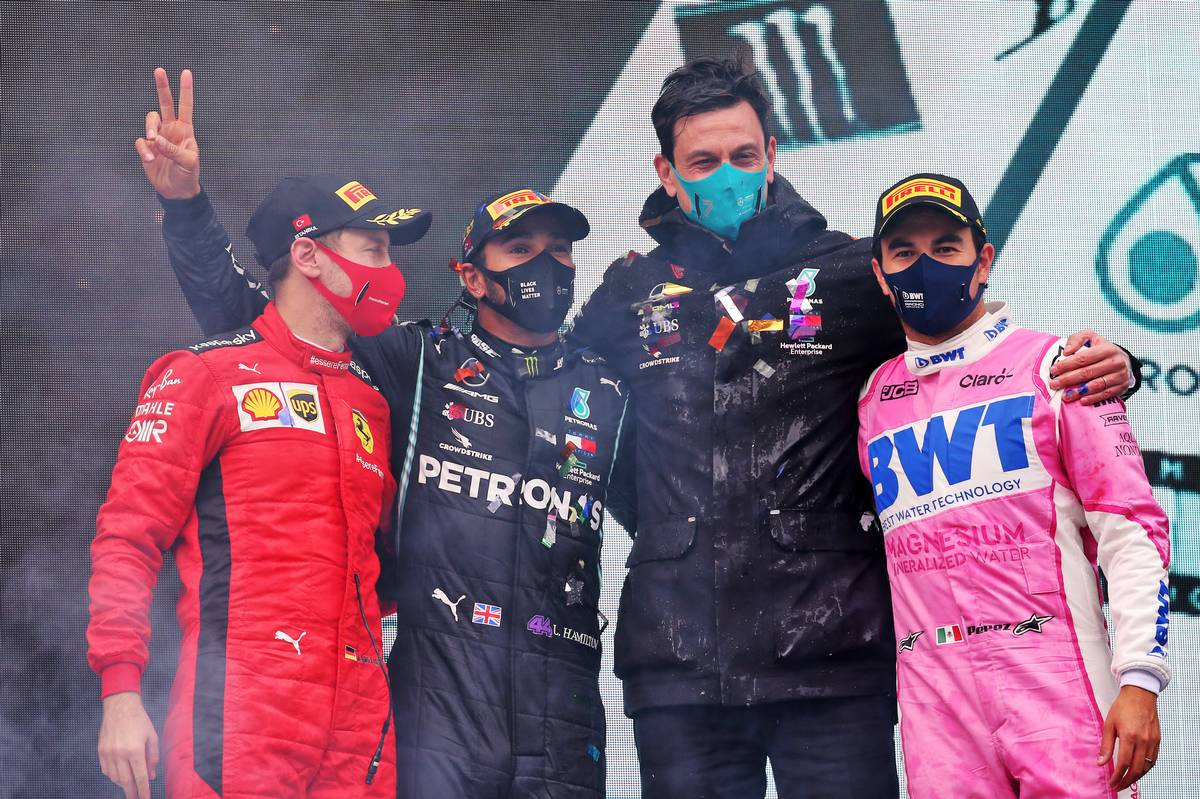 The podium (L to R): Sebastian Vettel (GER) Ferrari, third; Lewis Hamilton (GBR) Mercedes AMG F1, race winner and World Champion; Toto Wolff (GER) Mercedes AMG F1 Shareholder and Executive Director; Sergio Perez (MEX) Racing Point F1 Team, second.