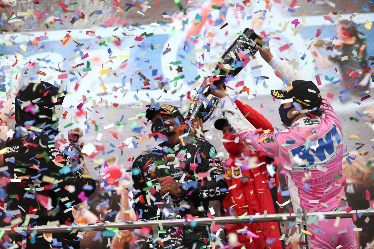 Race winner Lewis Hamilton (GBR) Mercedes AMG F1 celebrates winning his seventh World Championship and Sergio Perez (MEX) Racing Point F1 Team RP19.