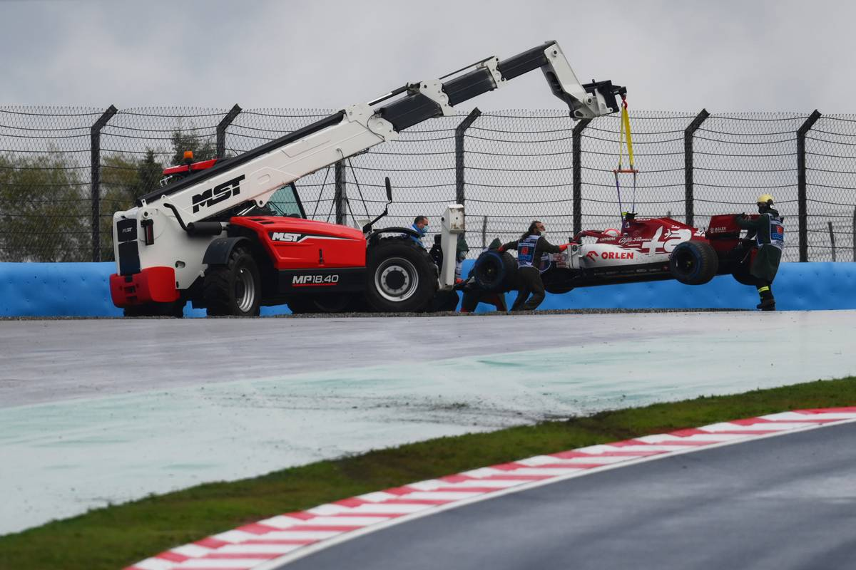 Antonio Giovinazzi (ITA) Alfa Romeo Racing C39 is craned out of the gravel trap after he crashed heading to the grid.