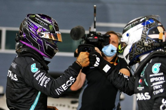 Lewis Hamilton (GBR) Mercedes AMG F1 W11 celebrates his pole position in qualifying parc ferme with team mate Valtteri Bottas (FIN) Mercedes AMG F1. 28.11.2020. Formula 1 World Championship, Rd 15, Bahrain Grand Prix, Sakhir, Bahrain, Qualifying Day. - www.xpbimages.com, EMail: requests@xpbimages.com © Copyright: Moy / XPB Images
