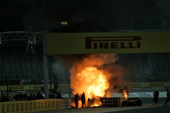 Marshals put out the fire of after Romain Grosjean (FRA) Haas F1 Team VF-20 crashed at the start of the race and exploded into flames. 29.11.2020. Formula 1 World Championship, Rd 15, Bahrain Grand Prix, Sakhir, Bahrain, Race Day. - www.xpbimages.com, EMail: requests@xpbimages.com © Copyright: Batchelor / XPB Images
