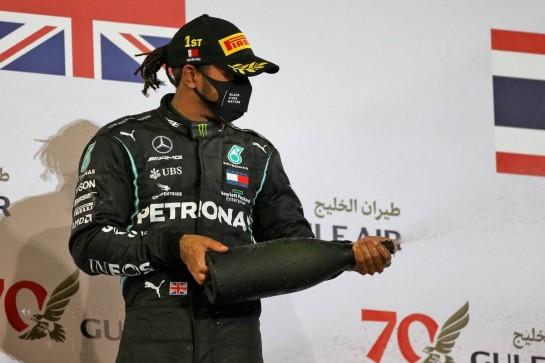 Race winner Lewis Hamilton (GBR) Mercedes AMG F1 celebrates on the podium. 29.11.2020. Formula 1 World Championship, Rd 15, Bahrain Grand Prix, Sakhir, Bahrain, Race Day. - www.xpbimages.com, EMail: requests@xpbimages.com © Copyright: Moy / XPB Images