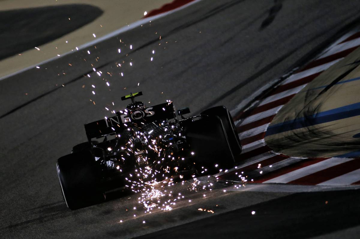 Valtteri Bottas (FIN) Mercedes AMG F1 W11 sends sparks flying.