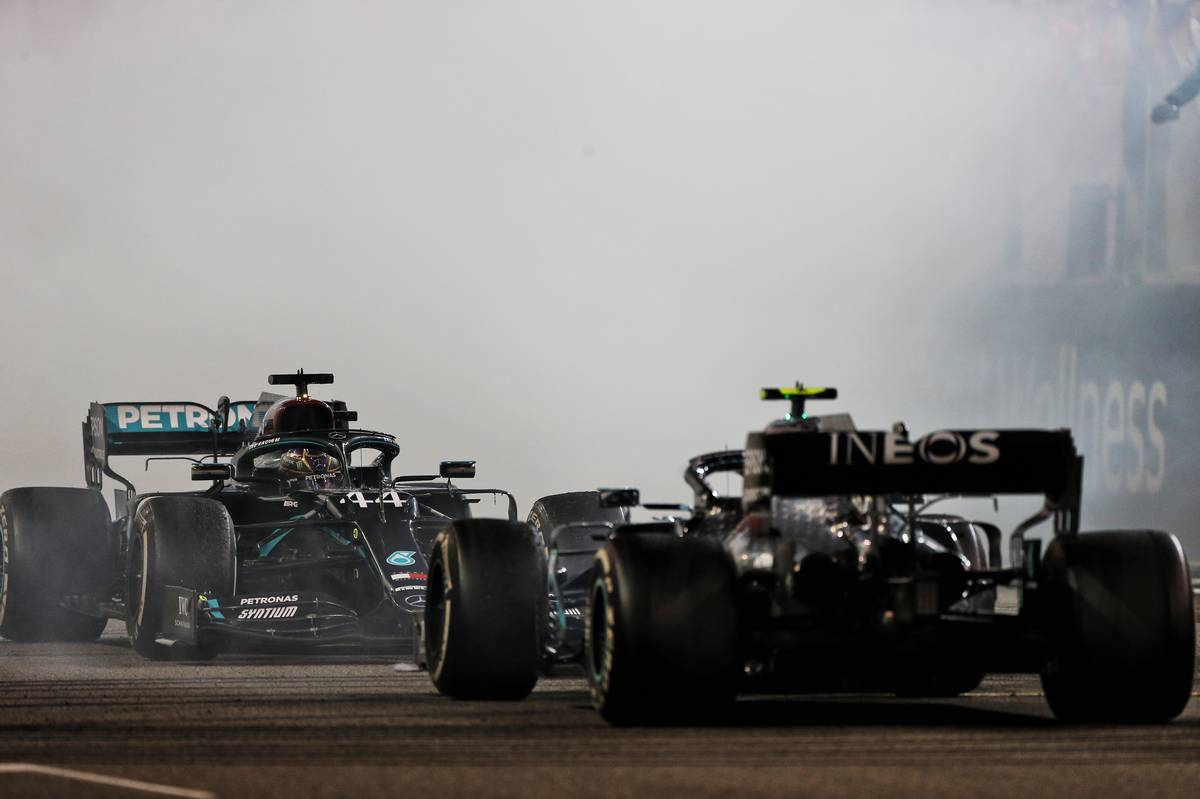 Lewis Hamilton (GBR) Mercedes AMG F1 W11 and Valtteri Bottas (FIN) Mercedes AMG F1 W11 - doughnuts at the end of the race. 13.12.2020. Formula 1 World Championship, Rd 17, Abu Dhabi Grand Prix