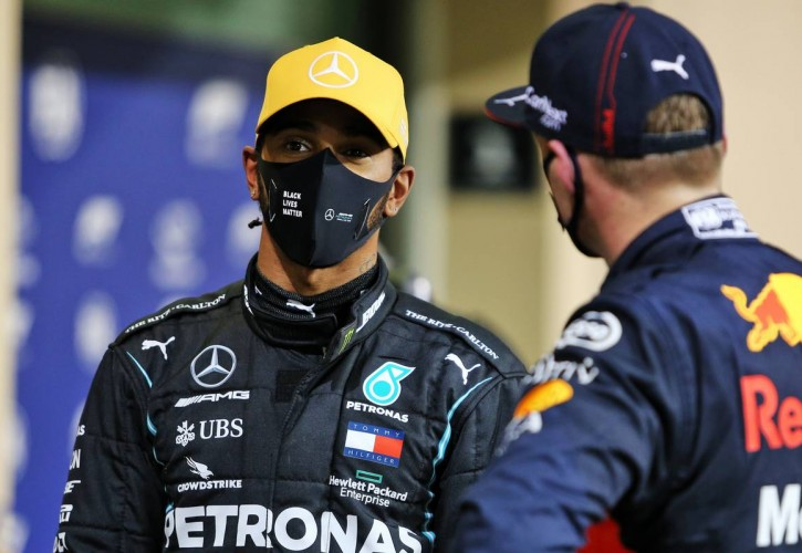 Lewis Hamilton (GBR) Mercedes AMG F1 in qualifying parc ferme with Max Verstappen (NLD) Red Bull Racing. 12.12.2020. Formula 1 World Championship, Rd 17, Abu Dhabi Grand Prix