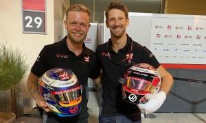 A friendly helmet swap for Haas' departing teammates