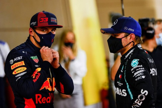 (L to R): Max Verstappen (NLD) Red Bull Racing with pole sitter Valtteri Bottas (FIN) Mercedes AMG F1 in qualifying parc ferme.