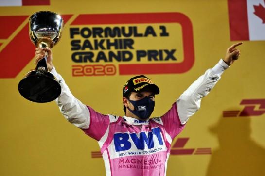 Race winner Sergio Perez (MEX) Racing Point F1 Team celebrates on the podium. 06.12.2020. Formula 1 World Championship, Rd 16, Sakhir Grand Prix, Sakhir, Bahrain, Race Day. - www.xpbimages.com, EMail: requests@xpbimages.com © Copyright: Batchelor / XPB Images