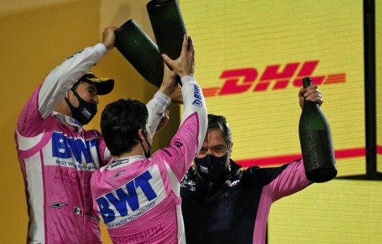 Andy Stevenson (GBR) Racing Point F1 Team Manager celebrates on the podium with race winner Sergio Perez (MEX) Racing Point F1 Team and Lance Stroll (CDN) Racing Point F1 Team. 06.12.2020. Formula 1 World Championship, Rd 16, Sakhir Grand Prix, Sakhir, Bahrain, Race Day. - www.xpbimages.com, EMail: requests@xpbimages.com © Copyright: Moy / XPB Images